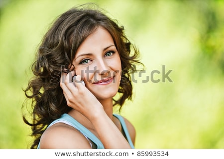 portrait of dark haired girl with cellphone stock photo © photography33