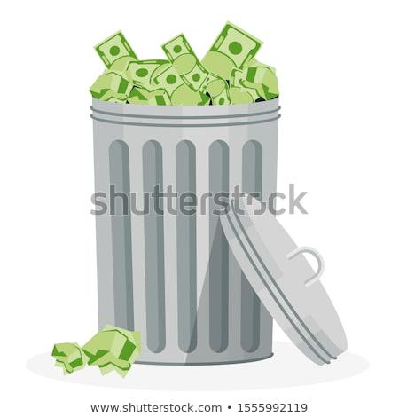 money flying into the trash stock photo © shutswis