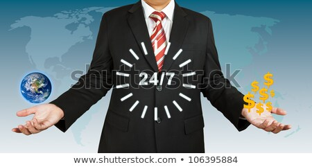 Businessman with 24 hour circle balance with US dollar stock photo © pinkblue