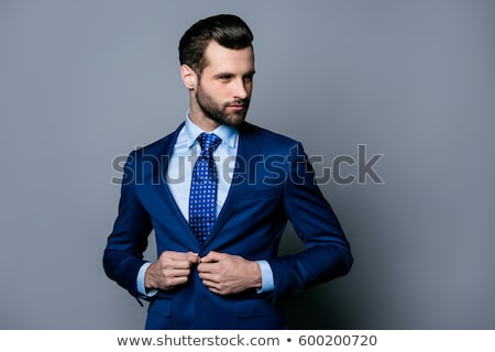 confident model wearing a suit stock photo © photography33