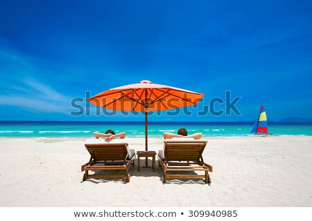 Under the parasol at the tropical white sand beach Stock photo © moses