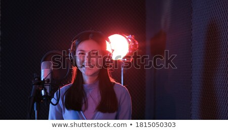 stunning woman singing into a microphone stock photo © photography33