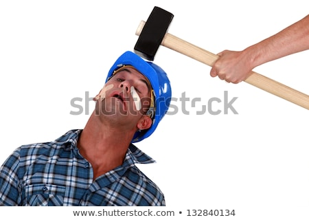 Injured tradesman being hit over the head with a mallet Stock photo © photography33