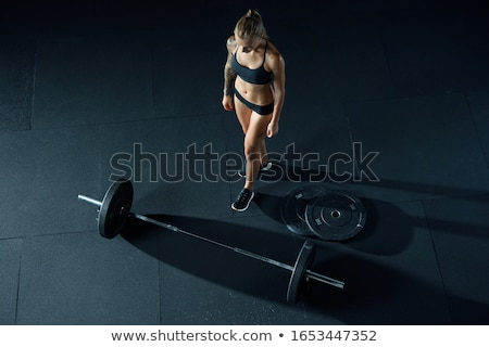 Fit active girl lifting weights for fitness stock photo © elenaphoto
