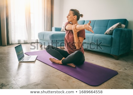 attractive young woman doing workout stretching stock photo © juniart