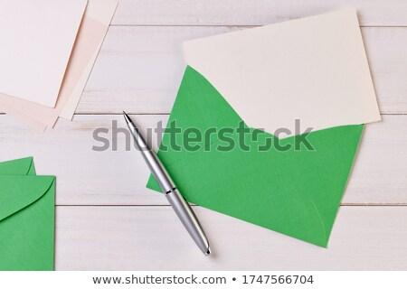 Mooie houten pen geïsoleerd witte papier Stockfoto © JohnKasawa