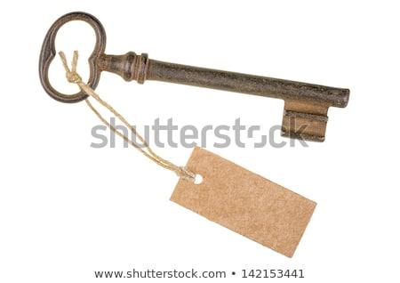 Vintage Key With A Tag On White Photo stock © Zerbor