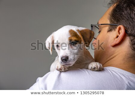 Portrait of a handsome man with his arms around his beautiful wi Stock photo © dacasdo
