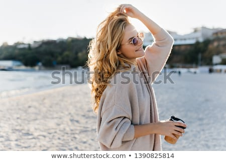 Blond girl with sunglasses on the beach Stock photo © lunamarina