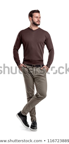 casual man looks away with hands in pockets stock photo © feedough