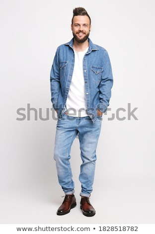 full length portrait of young confident barefoot man in blue jeans stock photo © gromovataya