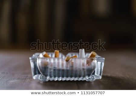 burning cigarette in an ashtray Stock photo © mariephoto