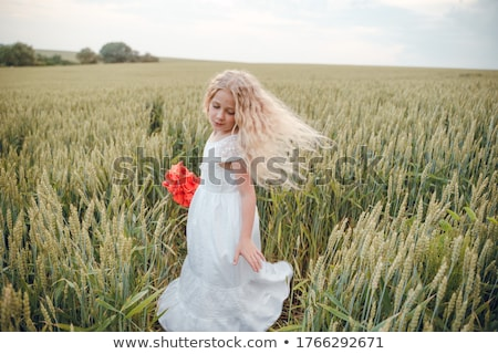beautiful blond girl with luxury bouquet of flowers stock photo © nejron