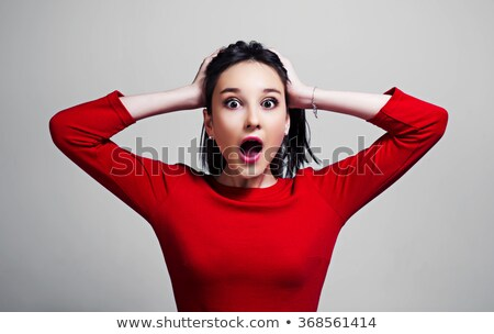 Young woman reacting in amazement Stock photo © dash