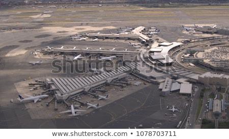 Avião voador fechar edifícios cidade janela Foto stock © gemenacom