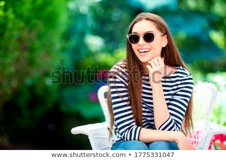 Portré boldog nő ül erkély virágok Stock fotó © deandrobot
