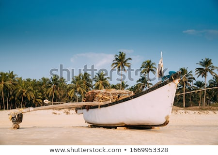 Old fishing boat standing on the sandy beach. India, Goa Stock photo © mcherevan