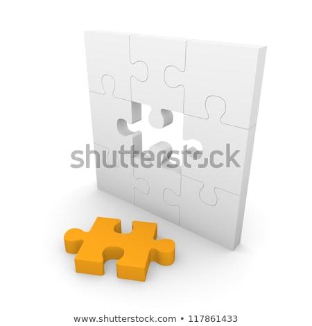 management   puzzle on the place of missing pieces stock photo © tashatuvango