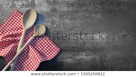 chalkboard and wooden spoons with a red checkered cloth stock photo © zerbor