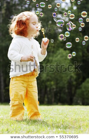 beautiful blonde in park with playing children on background Stock photo © Paha_L
