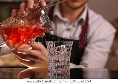 Koktél gin piros jégkockák narancs víz Stock fotó © netkov1