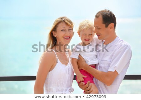 Happy family with little girl on veranda near seacoast Stock photo © Paha_L