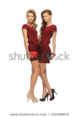 dois · belo · mulheres · vestidos · estúdio · retrato - foto stock © dolgachov