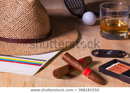 Siesta - cigar, straw hat,Scotch whiskey and golf driver on a wo Stock photo © CaptureLight