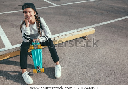 A girl rollerskating in the street Stock photo © bluering