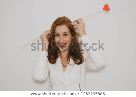 Angry Cupid Holding A Heart Stock photo © Dazdraperma