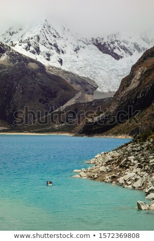Green boats at glacier lagoon in Peruvian Andes Stock photo © julianpetersphotos