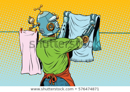 Vintage robot employee hangs up to dry clothes Stock photo © studiostoks