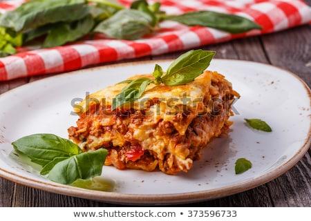 Porción lasaña albahaca placa decorado alimentos Foto stock © monkey_business