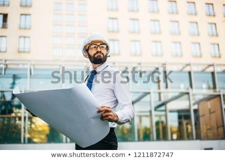 Architects examining blueprint Stock photo © LightFieldStudios