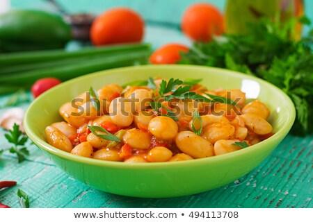 Puchar fasola pomidorów biały tabeli Zdjęcia stock © Digifoodstock