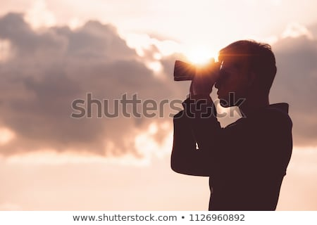 look businessman looking through binoculars stock photo © studiostoks