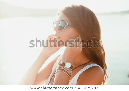 Beautiful brunette caucasian girl listening to the music with he Stock photo © boggy
