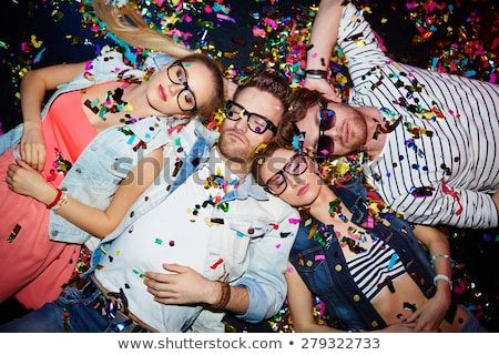 friends sleeping on floor after party stock photo © is2