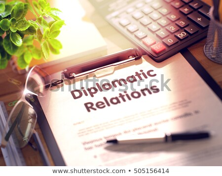 Clipboard with Diplomatic Relations Concept. 3D. Stock photo © tashatuvango