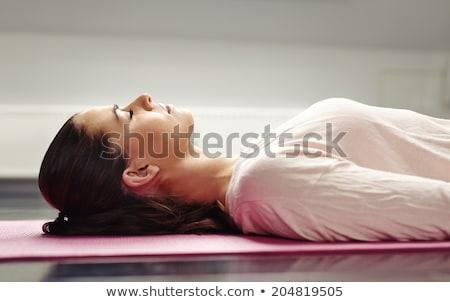 Egy nő megnyugtató padló nő jókedv portré Stock fotó © IS2