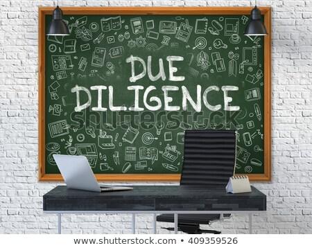 hand drawn due diligence on office chalkboard stock photo © tashatuvango