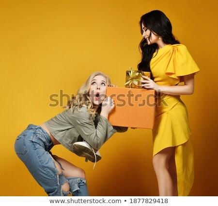 歳の女性 耳 現在 女性 笑みを浮かべて ストックフォト © IS2