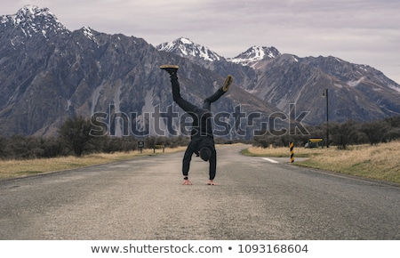 Young man doing back flip Stock photo © IS2