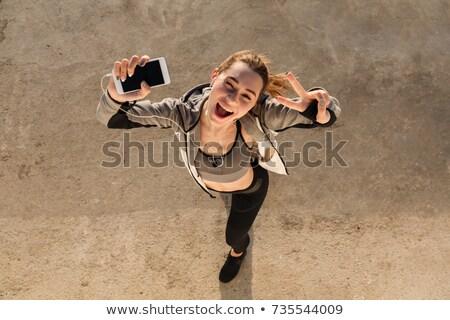 Felső kilátás boldog fitnessz lány fülhallgató Stock fotó © deandrobot