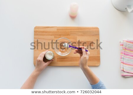 hands with spoon and jar making baby cereal Stock photo © dolgachov
