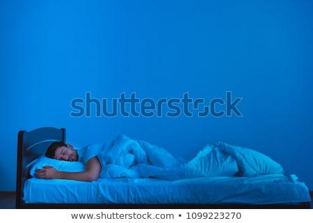 Férfi alszik ágy hálószoba férfi párna Stock fotó © IS2