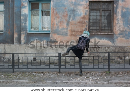 Woman climbing over wall Stock photo © IS2