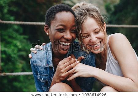 женщину смеясь подарок человека профиль сидят Сток-фото © IS2