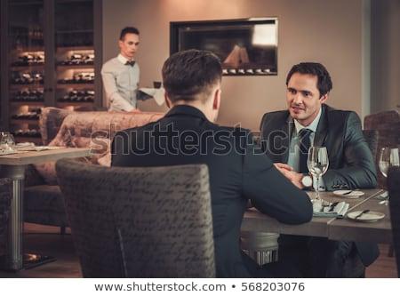 Kettő üzletemberek megbeszélés kávézó üzletember asztal Stock fotó © IS2