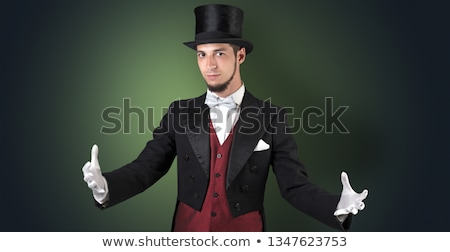 Сток-фото: Magician Holds Something Invisible